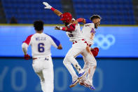 Dominican Republic's Jose Bautista (19) celebrate with Gustavo Nunez after hitting the game winning RBI single during the ninth inning of a baseball game against Israel at the 2020 Summer Olympics, Tuesday, Aug. 3, 2021, in Yokohama, Japan. The Dominican Republic won 7-6. (AP Photo/Matt Slocum)