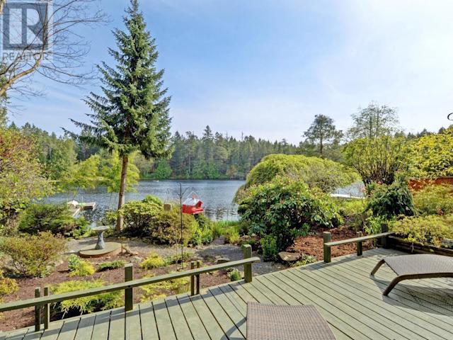 "<p><a href=""https://www.zoocasa.com/victoria-bc-real-estate/5299650-673-lost-lake-rd-victoria-bc-v9b6e3-391548"" rel=""nofollow noopener"" target=""_blank"" data-ylk=""slk:673 Lost Lake Rd., Victoria, B.C."" class=""link rapid-noclick-resp"">673 Lost Lake Rd., Victoria, B.C.</a><br> The property has 100 feet of waterfront, and the lake is private access only with only eight homes on it.<br> (Photo: Zoocasa) </p>"