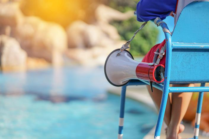 Lifeguards who are not actively monitoring the pool itself should be assigned to enforce things like social distancing, handwashing, the CDC said.