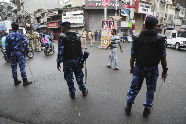 Rapid Action Force (RAF) soldiers stand guard in in Jammu, India, Friday, Aug. 9, 2019. The restrictions on public movement throughout Kashmir have forced people to stay indoors and closed shops and even clinics. All communications and the internet have been cut off. Prime Minister Modi said late Thursday the situation in the region would return to normal gradually. (AP Photo/Channi Anand)