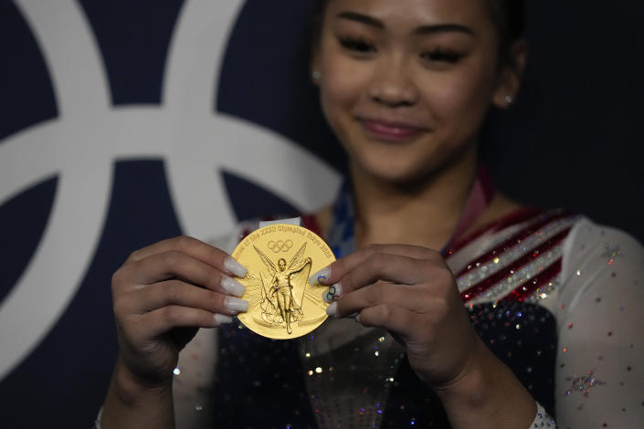 Sunisa Lee, of United States, poses for a picture after winning the gold medal in the artistic gymnastics women's all-around final at the 2020 Summer Olympics, Thursday, July 29, 2021, in Tokyo, Japan. (AP Photo/Gregory Bull)