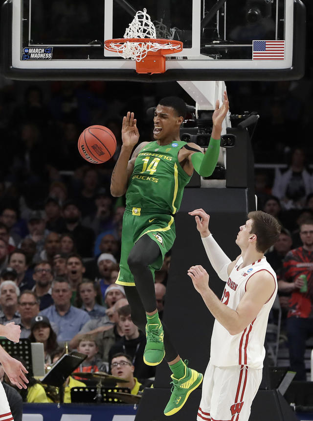 Oregon forward Kenny Wooten (14) reacts after dunking over Wisconsin forward Ethan Happ during the second half of a first-round game in the NCAA mens college basketball tournament, Friday, March 22, 2019, in San Jose, Calif. (AP Photo/Chris Carlson)