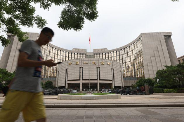 BEIJING, CHINA - JULY 20: A man walks past the People's Bank of China (PBOC) building on July 20, 2021 in Beijing, China. (Photo by Jiang Qiming/China News Service via Getty Images) (Photo: China News Service via Getty Images)