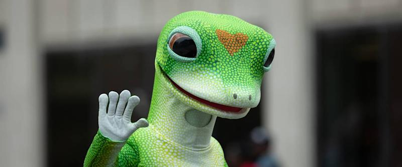 Man wearing the Geico insurance gecko mascot outfit.