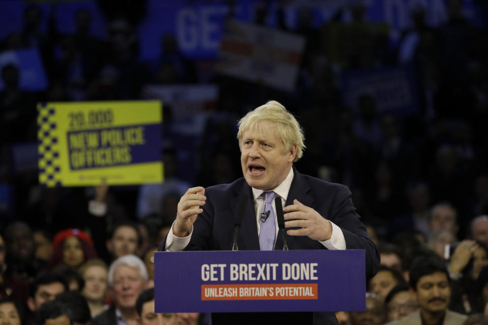 Britain's Prime Minister Boris Johnson speaks during his ruling Conservative Party's final election campaign rally at the Copper Box Arena in London, Wednesday, Dec. 11, 2019. Britain goes to the polls on Dec. 12. (AP Photo/Kirsty Wigglesworth)