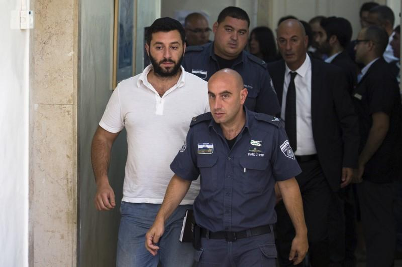 Shalon, who is accused by U.S. authorities of engaging in a stock manipulation scheme involving U.S. penny stocks, arrives at a courtroom at the Jerusalem Magistrates Court