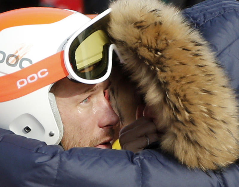 Men's super-G joint bronze medal winner Bode Miller of the United States is consoled by his wife, Morgan, at the Sochi 2014 Winter Olympics, Sunday, Feb. 16, 2014, in Krasnaya Polyana, Russia. (AP Photo/Christophe Ena)