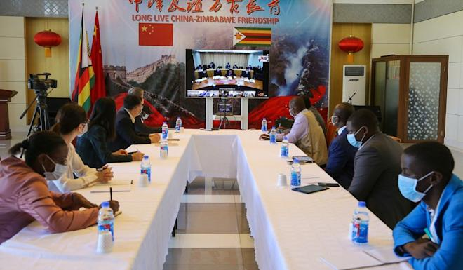 Government and health officials from Zimbabwe take part in a videoconference on the Covid-19 pandemic with experts from China. Photo: Xinhua