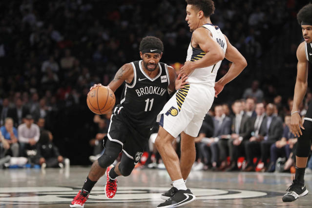 Brooklyn Nets guard Kyrie Irving (11) drives around Indiana Pacers guard Malcolm Brogdon (7) during the second half of an NBA basketball game Wednesday, Oct. 30, 2019, in New York. (AP Photo/Kathy Willens)