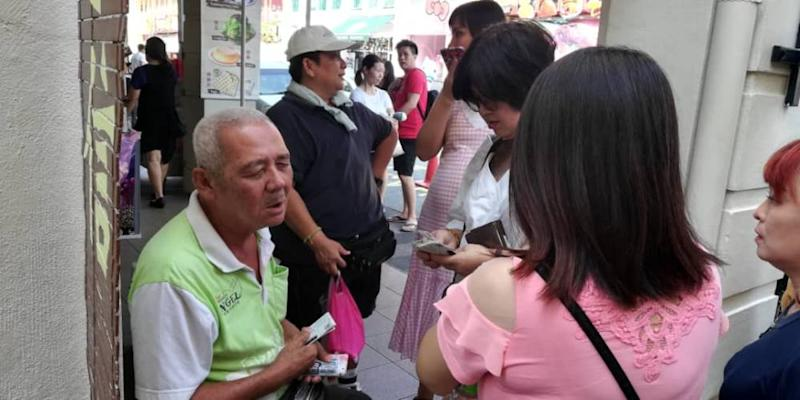 The elderly blind ticket seller can be found around Gunung Rapat, Pasir Pinji, Ipoh Jaya, Jalan Permaisuri Bainun, the Old Town areas and Concubine Lane in Ipoh. ― Picture courtesy of Big Sweep