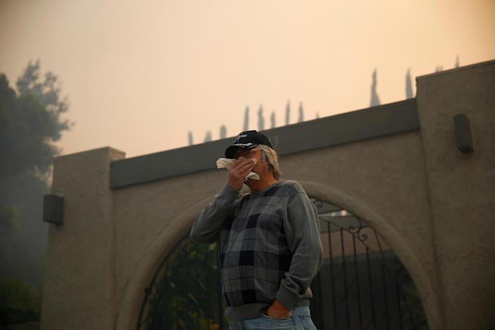 <p>A man looks on as firefighters battle the Peak Fire in Simi Valley, Calif. on Monday. (Photo: Eric Thayer/Reuters) </p>