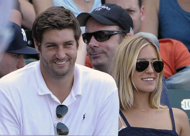 Chicago Bears quarterback Jay Cutler, left, and his wife Kristin Cavallari watch the Chicago Cubs play the Chicago White Sox during an interleague baseball game in Chicago. (AP Photo/Brian Kersey, File)