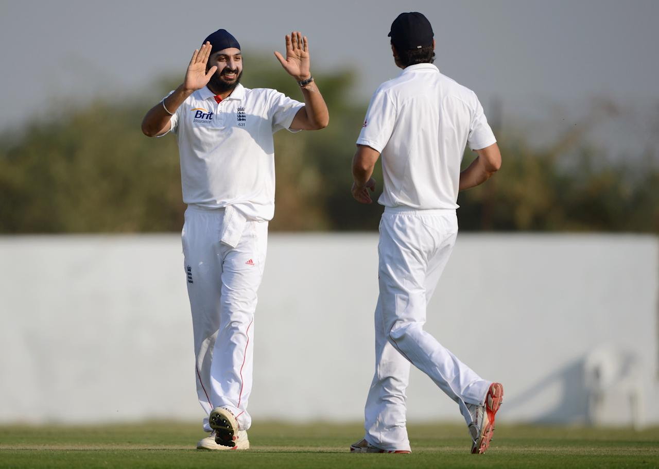 AHMEDABAD, INDIA - NOVEMBER 09:  Monty Panesar of England celebrates with Alastair Cook after dismissing Sachin Rana of Haryana during day two of the tour match between England and Haryana at Sardar Patel Stadium ground B on November 9, 2012 in Ahmedabad, India.  (Photo by Gareth Copley/Getty Images)