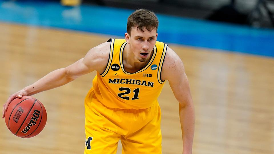Michigan guard Franz Wagner dribbles up court during a Sweet 16 game against Florida State in the NCAA men's college basketball tournament at Bankers Life Fieldhouse, Sunday, March 28, 2021, in Indianapolis. (AP Photo/Jeff Roberson) ORG XMIT: NYOTK