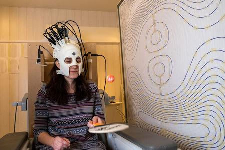 A woman is seen wearing a lightweight and highly sensitive brain imaging device in this undated handout photograph supplied by Wellcome and released in London, Britain March 22, 2018.  Wellcome/Handout via REUTERS