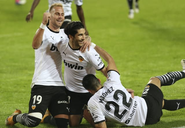 Carlos Soler, centre, was the hero for Valencia with three goals from the penalty spot against Real Madrid