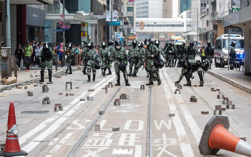 Hong Kong police removed bricks in the Central district of the city on Thursday - Bloomberg