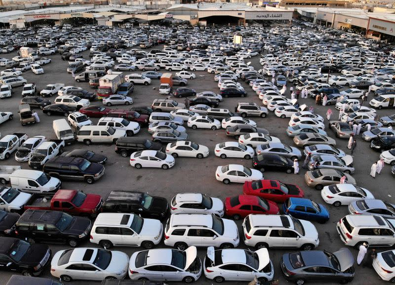 People gather to buy cars before the expected increase of VAT to 15% in Riyadh