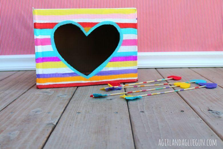 """<p> DIY a box with a heart-shaped target, along with some (not-so-pointy) arrows with felt-heart tips. Let the kids take turns seeing if they can throw the arrows into the target. Whoever gets the most in, wins! </p><p><em><a href=""""http://www.agirlandagluegun.com/2014/02/19835.html"""" rel=""""nofollow noopener"""" target=""""_blank"""" data-ylk=""""slk:Get the tutorial at A Girl and a Glue Gun »"""" class=""""link rapid-noclick-resp"""">Get the tutorial at A Girl and a Glue Gun »</a></em></p>"""