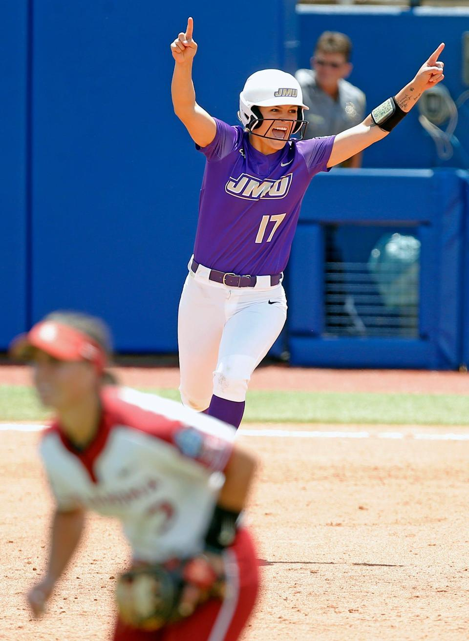 James Madison's Kate Gordon (17) celebrates her home run in the eighth inning against Oklahoma in Game 1 of the Women's College World Series.