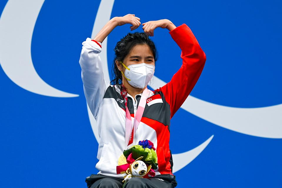 Gold medallist Singapore's Yip Pin Xiu celebrates on the podium after the women's 50m backstroke (S2) final at the 2020 Tokyo Paralympics. (PHOTO: Sport Singapore)