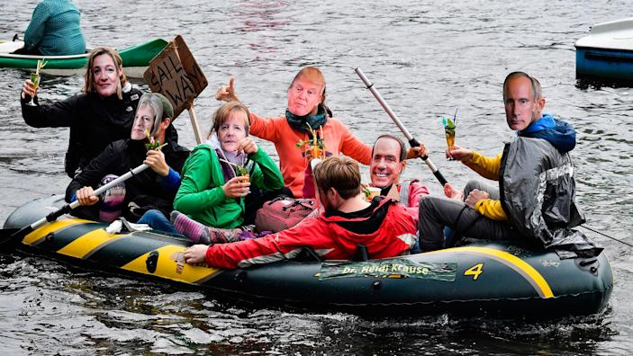 <p>JUL. 2, 2017 – Protestors with masks of politicians drink cocktails in a boat on the Alster river during a demonstration called by several NGOs ahead of the G20 summit in Hamburg. (Photo: John MacDougall/AFP/Getty Images) </p>