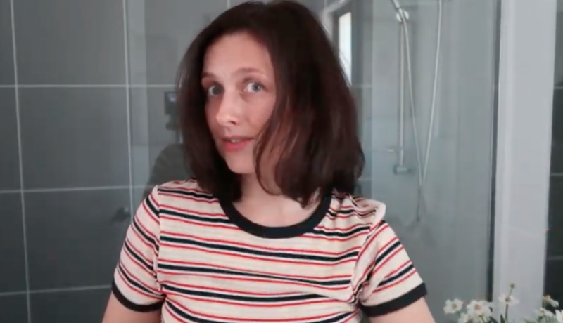 Woman shows effects of Aldi Special Buy styler brush in YouTube video product review.