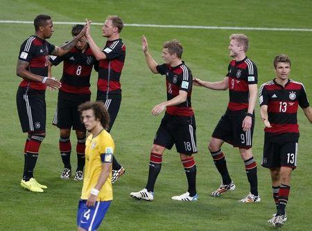 Germany's players celebrate past Brazil's David Luiz after Andre Schuerrle (2nd R) scores his team's sixth goal against Brazil during their 2014 World Cup semi-finals at the Mineirao stadium in Belo Horizonte July 8, 2014. REUTERS/David Gray