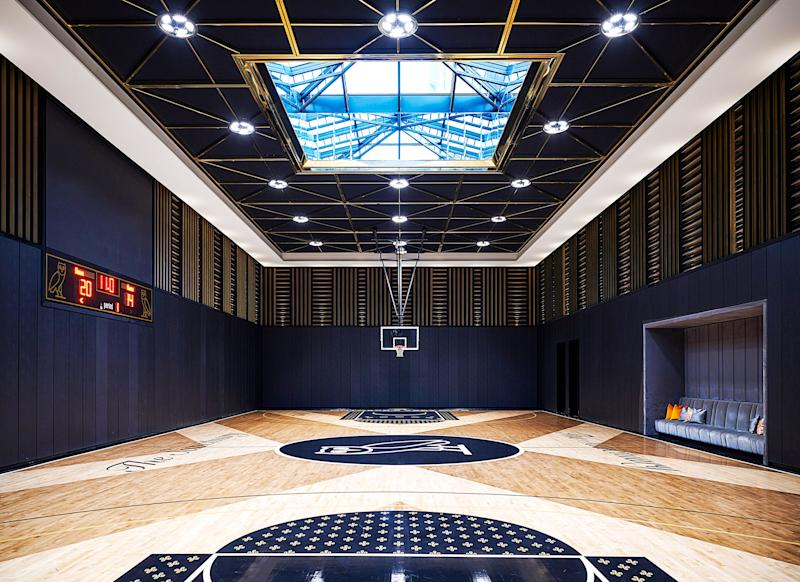 The official NBA-size court is painted with details inspired by Drake's lifestyle brand, October's Very Own.