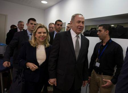 Israeli Prime Minister Benjamin Netanyahu (2ndR) and his wife Sara arrive at a courtroom to testify in a libel lawsuit they filed against an Israeli journalist, at the Magistrate Court in Tel Aviv, Israel