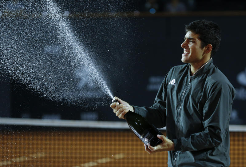 Chile's Cristian Garin celebrates after defeating Italy's Gianluca Mager at the final match of the Rio Open tennis tournament in Rio de Janeiro, Brazil, Sunday, Feb. 23, 2020. (AP Photo/Luciano Belford)