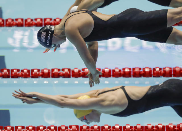 United States' Katie Ledecky starts in the women's 400m freestyle final at the World Swimming Championships in Gwangju, South Korea, Sunday, July 21, 2019. (AP Photo/Mark Schiefelbein)