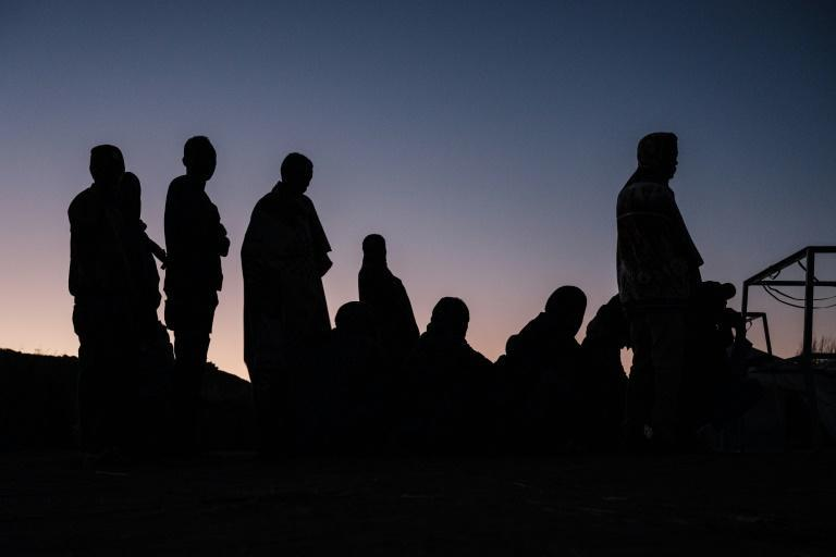 In need: People displaced by the Tigray conflict queue for food at sunrise at the Um Raquba refugee camp in eastern Sudan