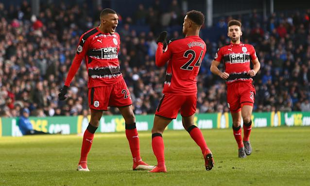 Steve Mounié celebrates scoring Huddersfield's second goal against West Brom.