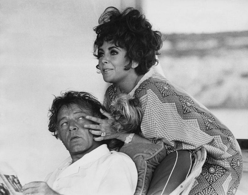 <p>The costars and real-life couple relax while sailing off of the coast of Sardinia, Italy on their yacht, Kalizma, while filming <em>Boom</em> in 1967.</p>