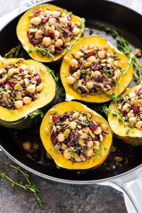 "<p>This completely vegan stuffed squash is filled with wild rice, cranberries, and chickpeas. It can be a Thanksgiving side dish, or an entire meal on any other weeknight. The recipe makes six servings, so cut everything in thirds to make enough for just two. </p><p><strong>Get the recipe:</strong> <a href=""http://www.wellplated.com/instant-pot-acorn-squash/"" class=""link rapid-noclick-resp"" rel=""nofollow noopener"" target=""_blank"" data-ylk=""slk:instant pot acorn squash stuffed with wild rice, cranberries, and chickpeas"">instant pot acorn squash stuffed with wild rice, cranberries, and chickpeas</a></p>"