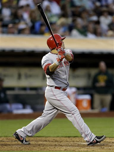 Cincinnati Reds' Shin-Soo Choo watches his RBI sacrifice fly off Oakland Athletics' Tommy Milone in the fifth inning of a baseball game Tuesday, June 25, 2013, in Oakland, Calif. (AP Photo/Ben Margot)