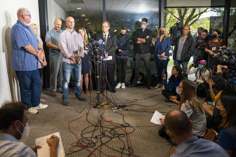 Jim Schmidt, stepfather of Gabby Petito, whose death on a cross-country trip has sparked a manhunt for her boyfriend Brian Laundrie, speaks alongside family members during a news conference, Tuesday, Sept. 28, 2021, in Bohemia, N.Y. (AP Photo/John Minchillo)