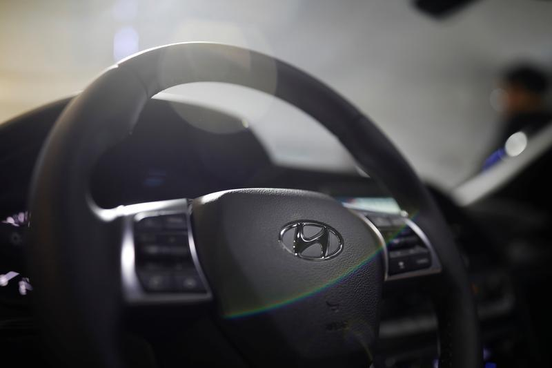 The logo of Hyundai Motor is seen on the steering wheel of a Sonata sedan car during its unveiling ceremony in Seoul