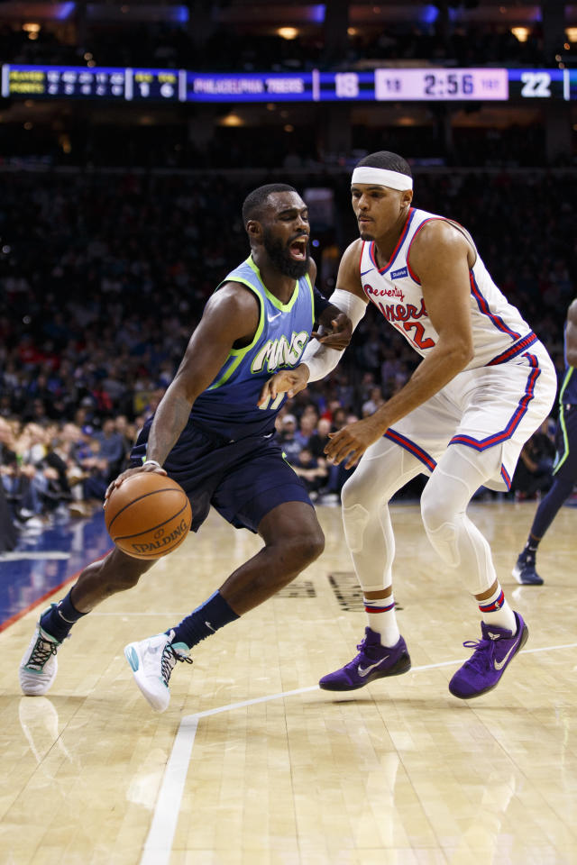 Dallas Mavericks' Tim Hardaway Jr., left, makes his move against Philadelphia 76ers' Tobias Harris, right, during the first half of an NBA basketball game, Friday, Dec. 20, 2019, in Philadelphia. (AP Photo/Chris Szagola)