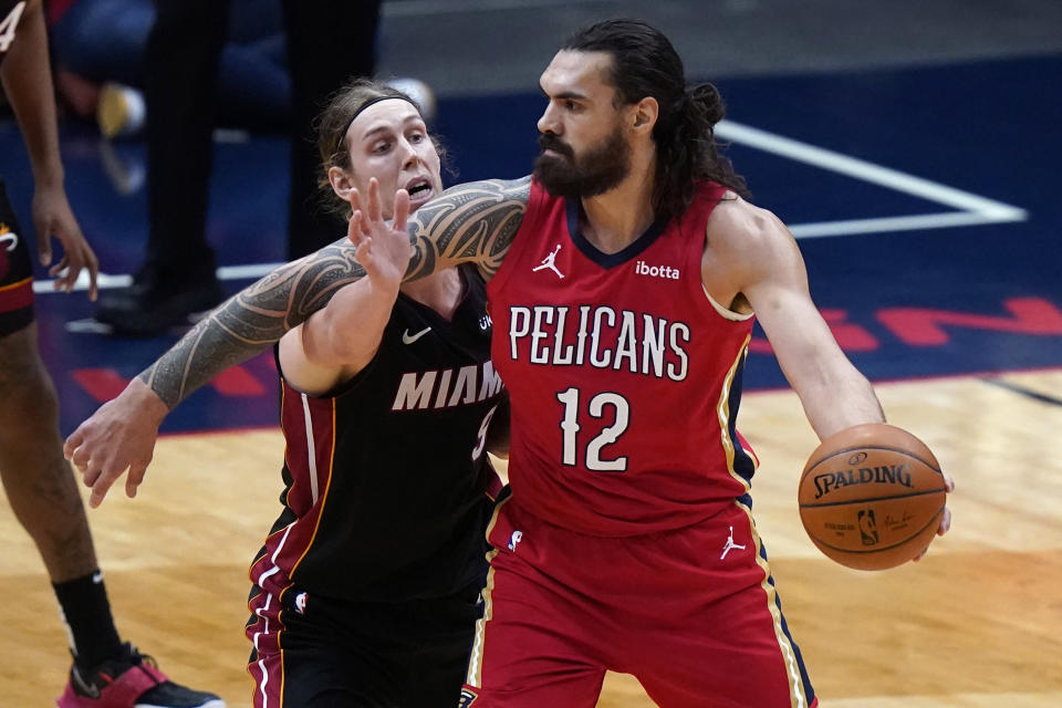 New Orleans Pelicans center Steven Adams (12) looks to pass the ball as Miami Heat forward Kelly Olynyk (9) defends during the first half of an NBA basketball game in New Orleans, Thursday, March 4, 2021. (AP Photo/Gerald Herbert)