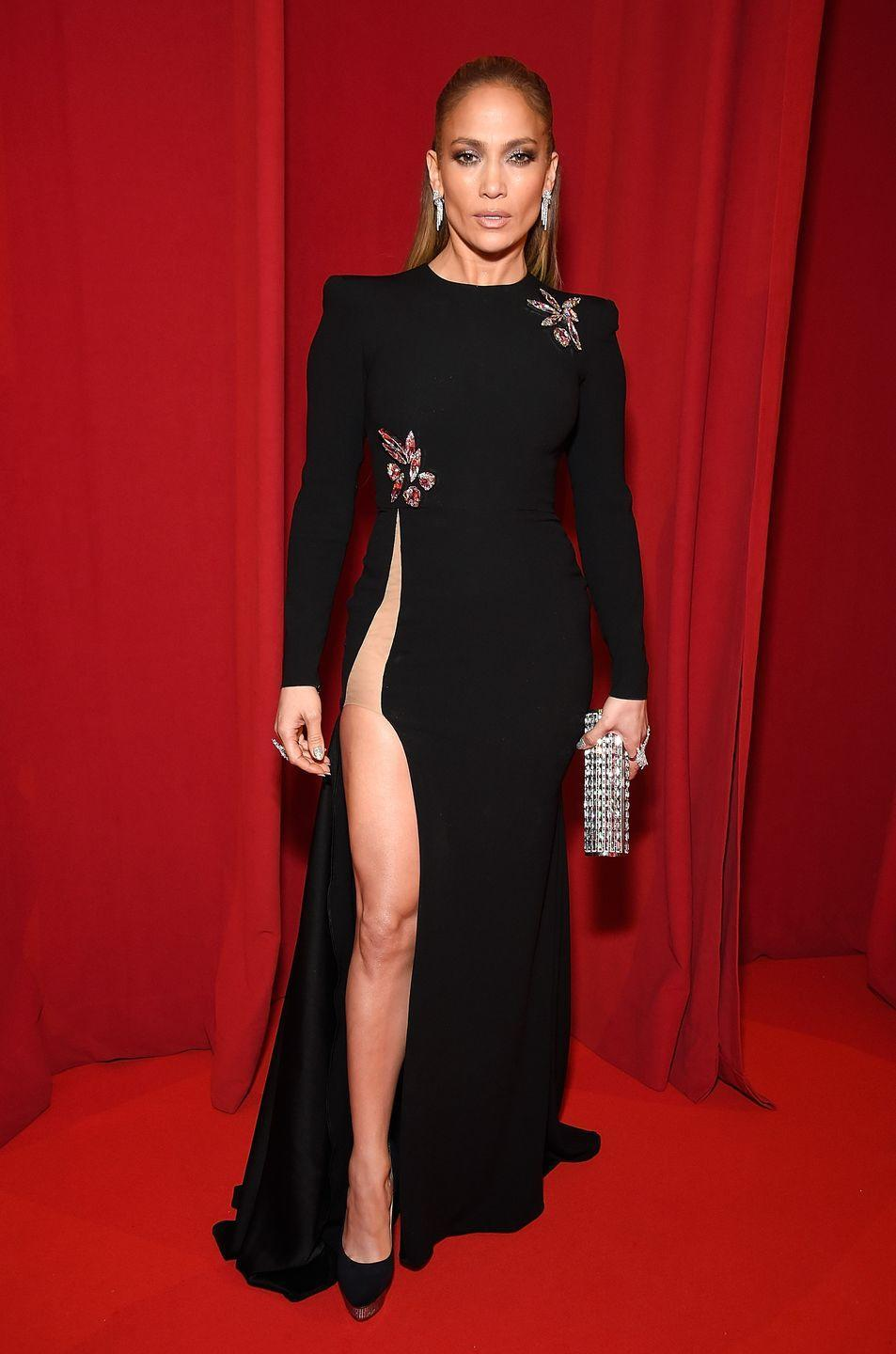 <p>Jennifer Lopez makes a statement in an embellished long-sleeve dress with a SUPER-high slit at The Robin Hood Foundation's 2018 benefit in New York City.</p>