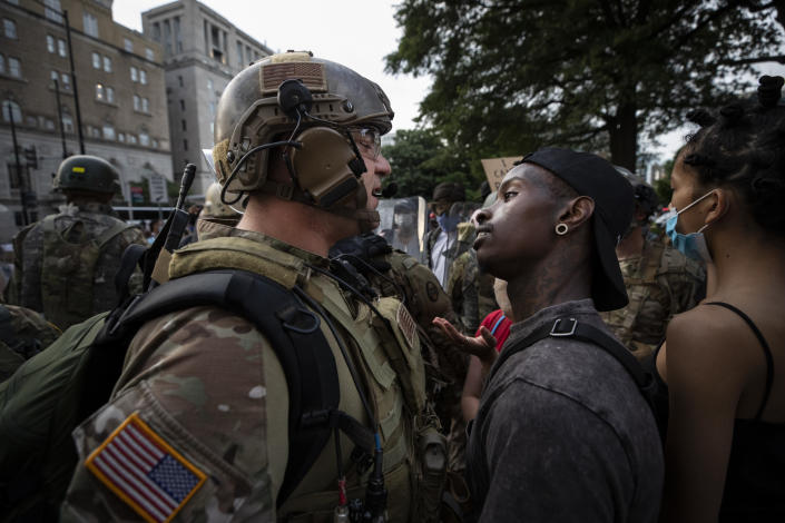 A demonstrator stares at a National Guard solider as protests continue over the death of George Floyd, June 3, 2020, near the White House in Washington, D.C. The image was part of a series of photographs by The Associated Press that won the 2021 Pulitzer Prize for breaking news photography. (AP Photo/Alex Brandon)