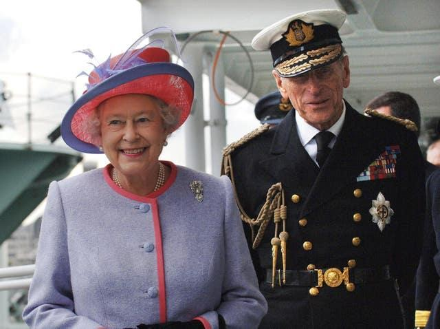 The duke, in his Naval uniform, with the Queen