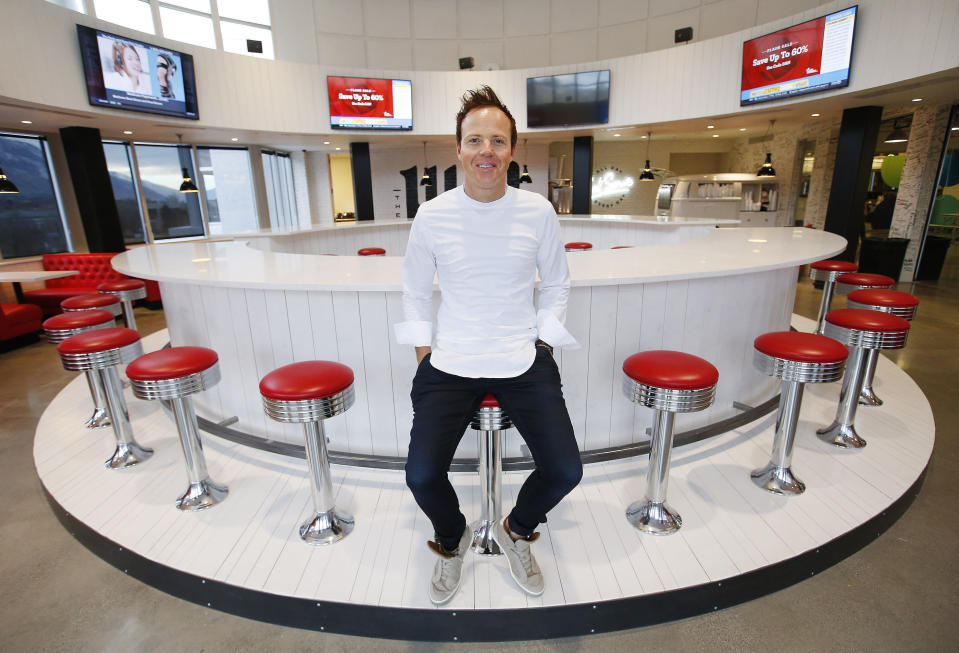 """FILE - In this Feb. 2, 2018, file photo, Qualtrics CEO Ryan Smith poses in the Hub at the company's headquarters in Orem, Utah. Survey-software provider Qualtrics went public Thursday, Jan. 28, 2021, two years after German software giant SAP bought the company for $8 billion, marking the latest achievement for a company that has become one of the crown jewels of a technology corridor near Salt Lake City that Utah likes to call """"Silicon Slopes."""" (Jeffrey D. Allred/The Deseret News via AP)"""
