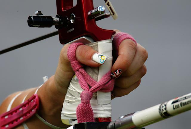 LONDON, ENGLAND - JULY 29: A detail view of the hand and nail varnish of Amy Oliver of Great Britain in action during the Women's Team Archery Eliminations match between Great Britain and Russia on Day 2 of the London 2012 Olympic Games at Lord's Cricket Ground on July 29, 2012 in London, England. (Photo by Paul Gilham/Getty Images)