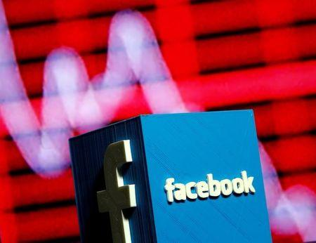 FILE PHOTO:    A 3D-printed Facebook logo is seen in front of a displayed stock graph in this illustration taken