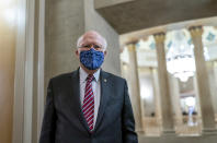 Sen. Patrick Leahy, D-Vt., the president pro tempore of the Senate, pauses in a corridor off the Rotunda as he awaits the article of impeachment against Donald Trump to be delivered, at the Capitol in Washington, Monday, Jan. 25, 2021. The Senate's longest-serving member, 80-year-old Vermont Democrat Patrick Leahy, was taken to a hospital Tuesday evening for observation after not feeling well, a spokesman said. (AP Photo/J. Scott Applewhite))