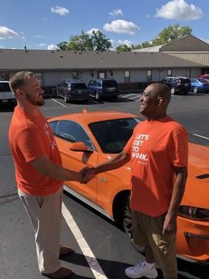 Spherion employee Michael Pennington receives the Spherion Works Sweepstakes grand prize, a new Ford Mustang GT.