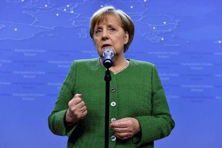 Germany's Chancellor Merkel gives a statement after a European Union leaders informal summit in Brussels